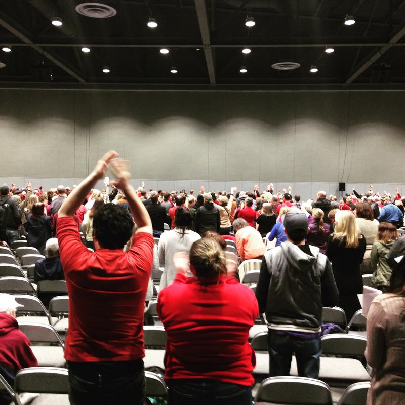 The crowd at a 2016 public meeting in Tacoma rises when asked to stand if they oppose the proposed methanol plant.