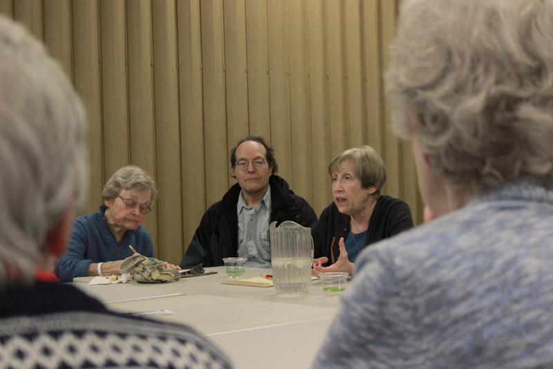 Carin Mack (center right), a geriatric social worker, leads a discussion on avoiding loneliness, like volunteer work.`