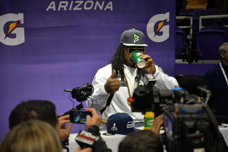 Running back Marshawn Lynch talks with reporters on Jan. 27, 2015.