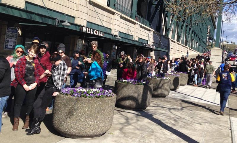 People wait for the gates at Safeco Field to open for Bernie Sanders' rally on Friday, March 25.