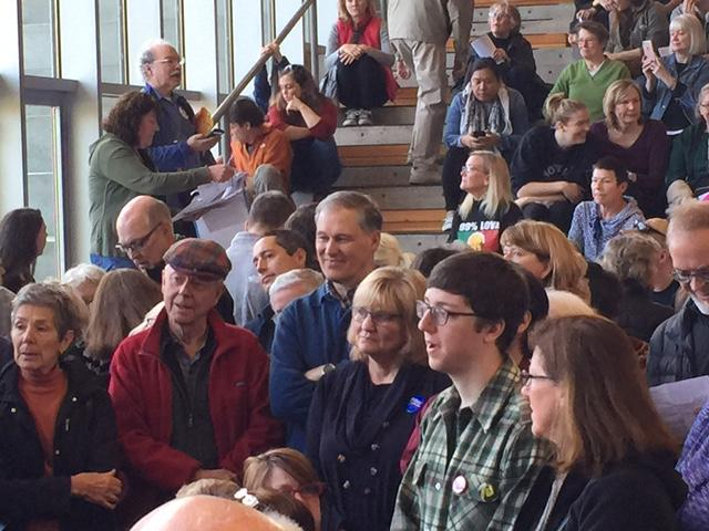 Gov. Jay Inslee (center) joins caucus-goers in Bainbridge Island.
