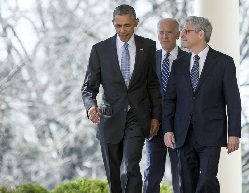 Federal appeals court judge Merrick Garland walks with President Barack Obama and Vice President Joe Biden from the Oval Office to the Rose Garden to be introduced as Obama's nominee for the Supreme Court at the White House, Wed., March 16, 2016.