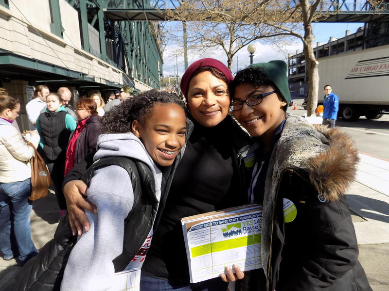 Niah, April and Jasmyne Sims pose outside Safeco Field before the Bernie Sanders rally Friday in Seattle.