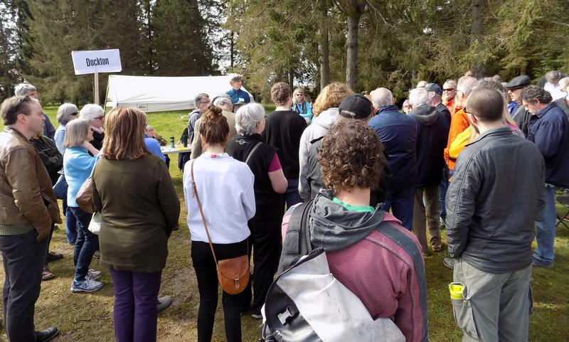 People from the Dockton community caucus at Vashon Island's Open Space community center on Saturday.