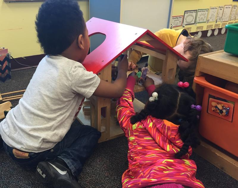 Preschoolers play with a dollhouse at Launch at Leschi Elementary School, one of Seattle Preschool Program's first sites.