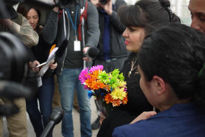 Nestora Salgado speaks to media at Sea-Tac Airport.