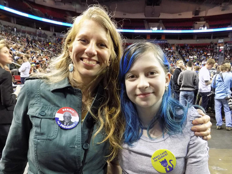 Melanie Forester and her daughter Coco Robalino. Robalino likes that Sanders wants to help her get a good education.