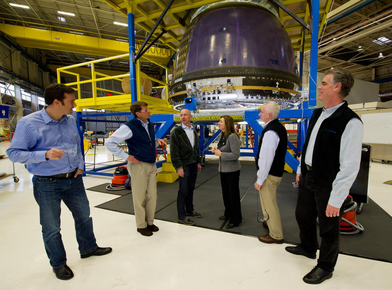 Blue Origin team members Bretton Alexander and Jeff Ashby, founder Jeff Bezos, NASA deputy administrator Lori Garver, and team members Rob Meyerson and Robert Millman at the company's headquarters in Kent in 2011.