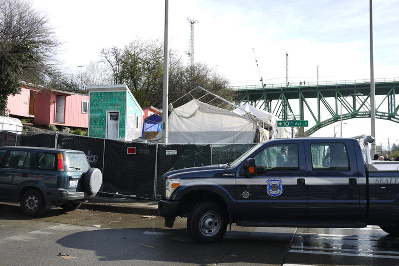 Police and city staff were on the site of the homeless encampment on South Dearborn Street to clear it on Friday, March 11.