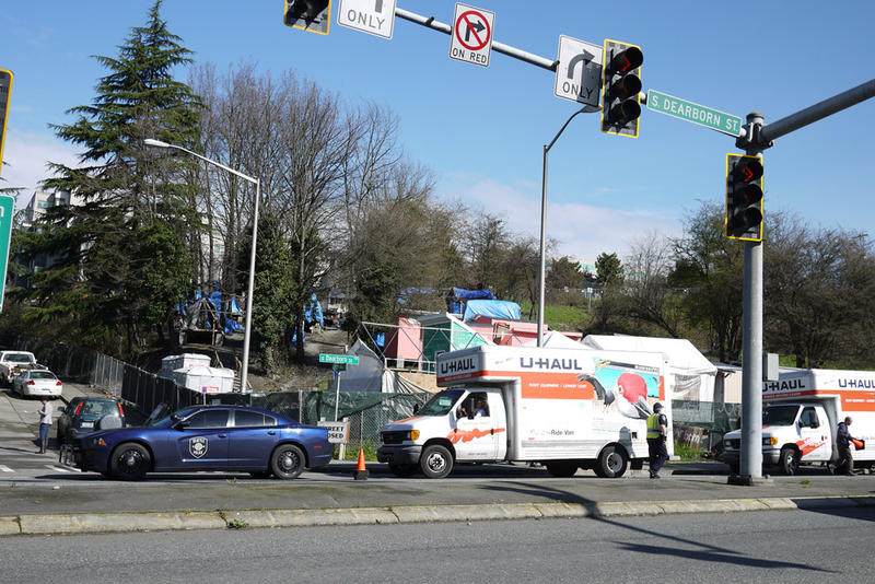 A U-Haul van stands outside the homeless encampment on South Dearborn Street that the city of Seattle cleared Friday, March 11.