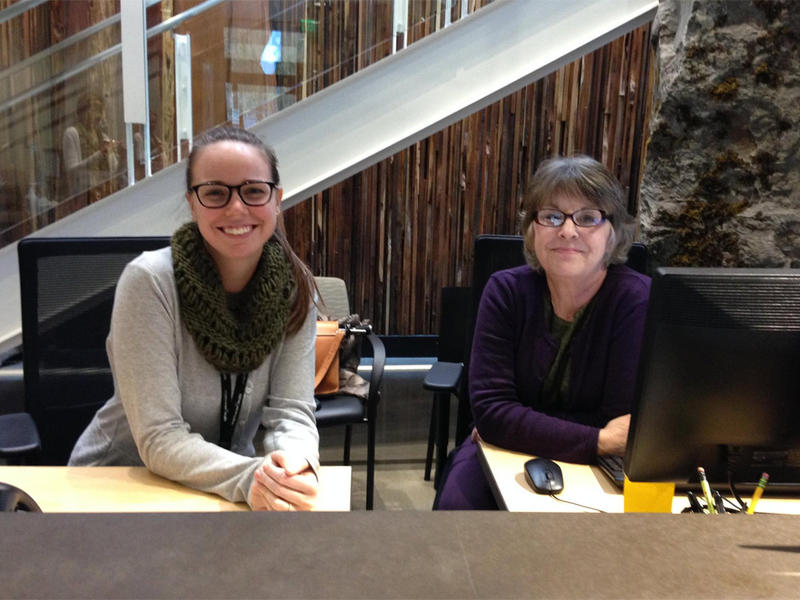 Emily Holt (left) and Kathleen Cromp staff the Welcome Desk at Meridian Center for Health. The clinic provides medical, dental, mental health and maternal support services under one roof.