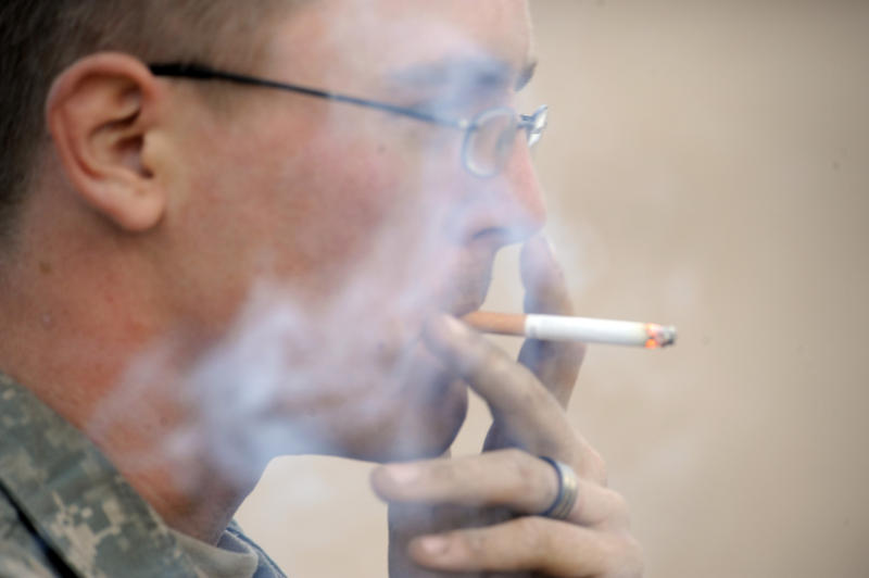 U.S. Army Pfc. Dustin Hein, with the 1st Battalion, 8th Infantry Regiment, 3rd Brigade Combat Team, 4th Infantry Division, smokes a cigarette between training missions at the National Training Center at Fort Irwin, Calif., Nov. 11, 2009.