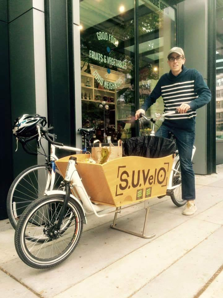 Benjamin Rasmus from Rotary First Harvest and a sweet box bike, picking up from Cone and Steiner General Store in Pioneer Square.