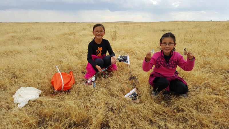 Rebecca Yeung (left), and Kimberly Yeung retrieve the Loki Lego Launcher outside Ritzville, WA, after the ballooncraft returned from the stratosphere.