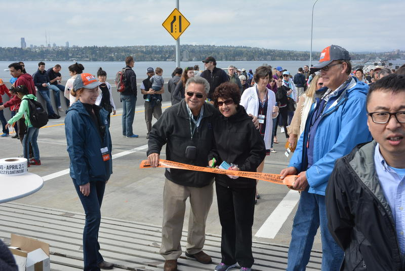 A couple poses during a staged ribbon-cutting ceremony on the new SR 520 bridge. The bridge was open to foot traffic over the weekend.
