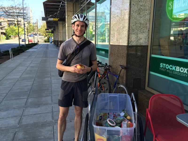 Seattle Food Rescue founder Tim Jenkins picks up food from Stock Box on James St.
