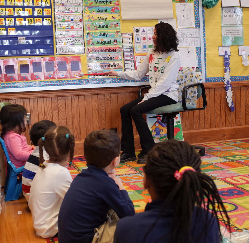 Preschool teacher Cindy Bly opens class at Quinsigamond School in Worcester, Massachusetts.  Many of the pupils in the school come from economically stressed families. Achievement here is ranked in the bottom fifth of the state.