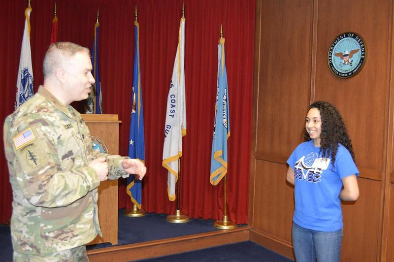Commander Lt. Col. Vylius Leskys administeres the Oath of Enlistment to Levani Ilasa, the first woman in the country to be enlisted into 19K - M1 Armor Crewman.