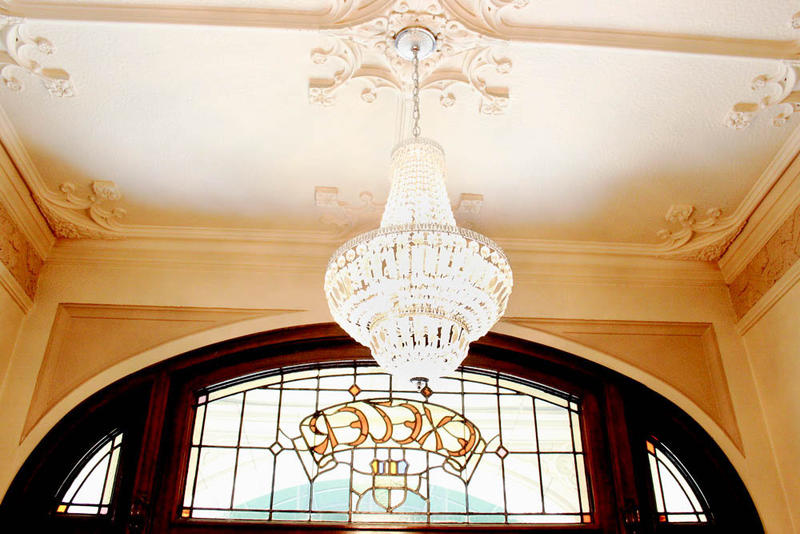 A chandalier hangs in the lobby at Exeter House, an old hotel turned senior housing. The Exeter House is being sold.