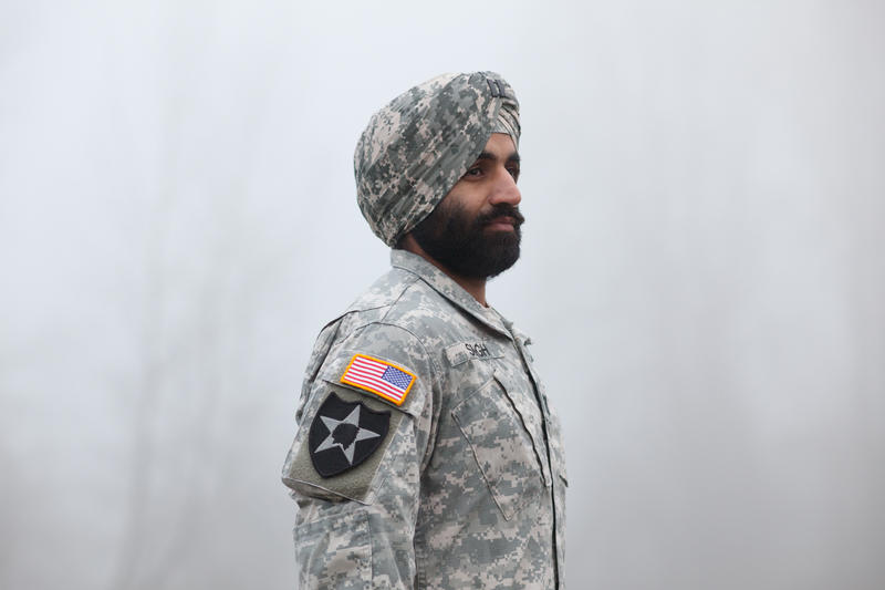 Captain Simratpal Singh with camouflage turban and beard.