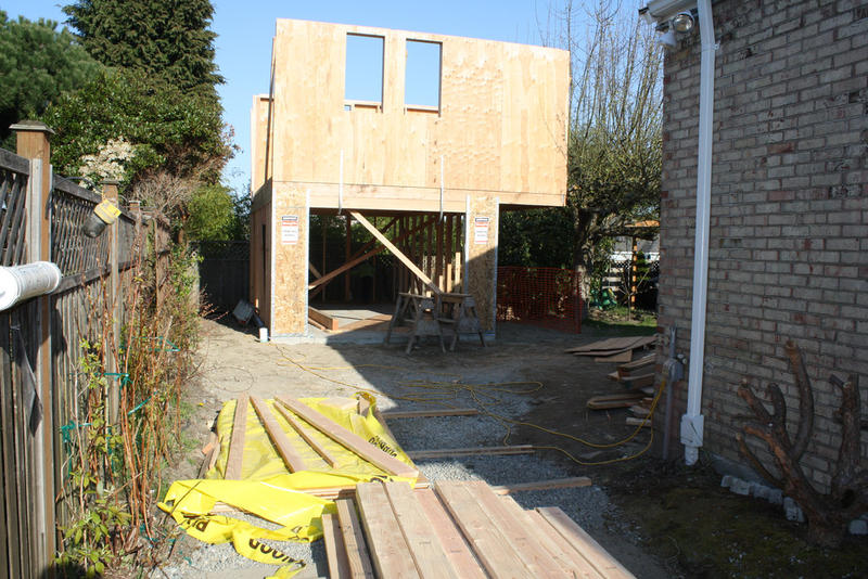 Jim Loter documented building a backyard cottage in Seattle. Here's a picture from day 25: erecting the walls.