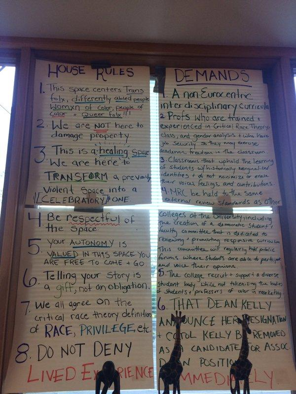 Demands posted in a window of the occupied space at Matteo Ricci College.