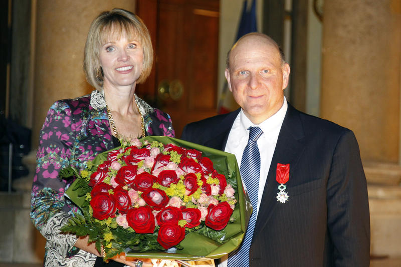 Former Microsoft CEO, Steve Ballmer, right, and his wife Connie pose on the steps of the Elysee Palace after he was awarded Knight of the Legion of Honor by France's President Nicolas Sarkozy on Feb. 16, 2011.