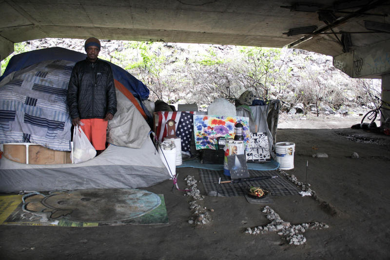 Some residents of the Jungle keep tidy encampments, like William Kowang above, while others live in garbage with needles strewn about.