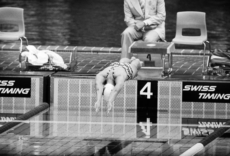 U.S. swimmer Wendy Boglioli dives in to the pool to begin the second heat in the women's 100 meter butterfly competition at the Olympic pool in Montreal, Canada, July 21, 1976.