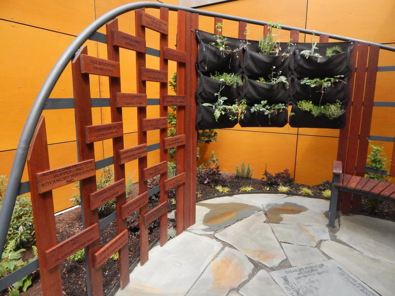 Native plants and mahogany framework and seating create a sacred   space for VA patients and their families.