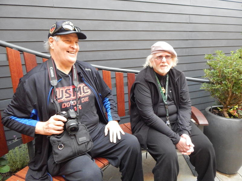 Marine veteran Jack Kegley and UW Assistant Professor Jeremy Watson enjoy the new healing garden built by UW students.