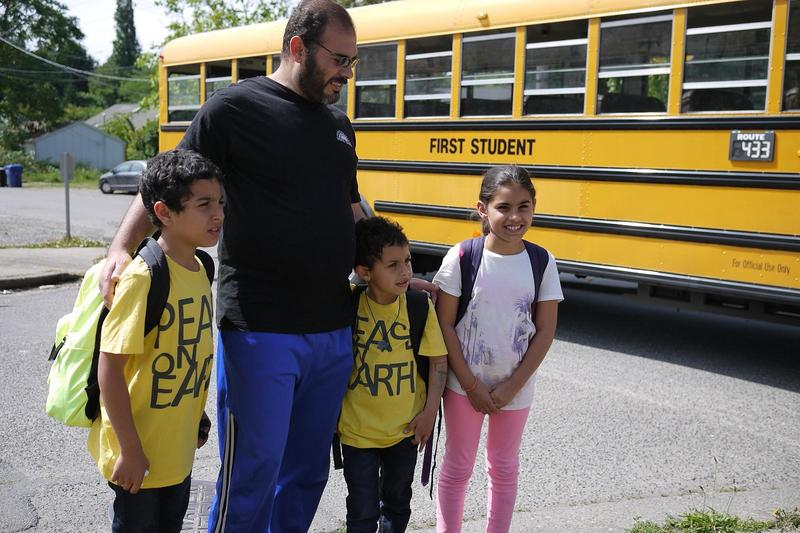Bassam Alhamdan, father of six, meets his kids at the bus stop every afternoon.