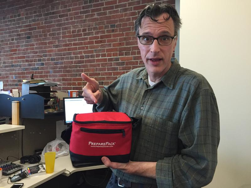 Bill Radke shows off the emergency kits we have for everyone at KUOW (but that's not enough to last us in a major catastrophe).