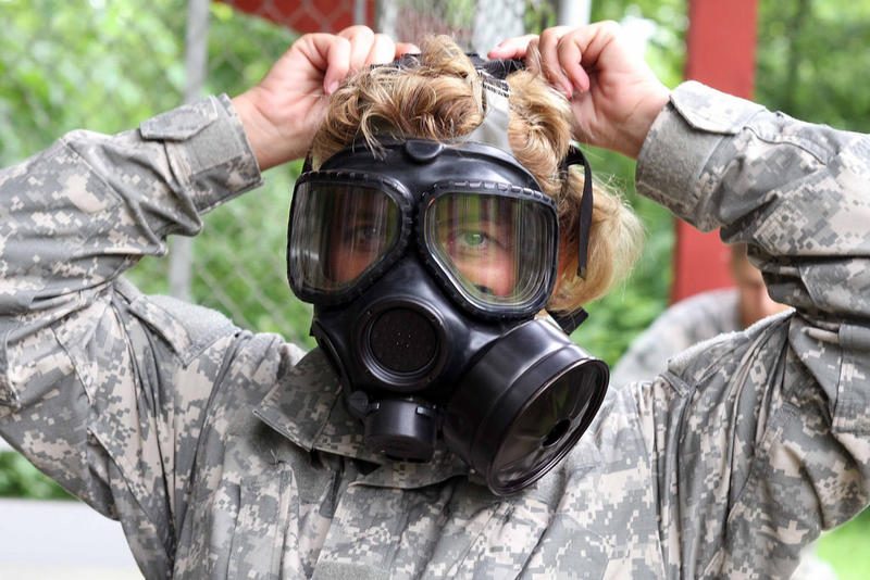 Pfc. Holly Horned of the Indiana Army National Guard adjusts her gas mask before entering a gas chamber during a nuclear, biological and chemical warfare training exercise at Camp Atterbury, Ind., June 15, 2010.