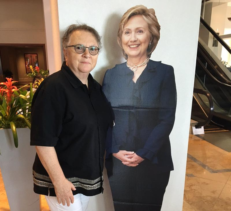 Susan Atlas poses with a cutout of Hillary Clinton at a hotel lobby in Philadelphia on Friday.