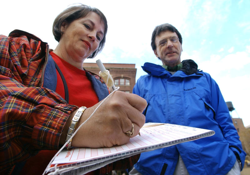 Mary Champine, left, adds her signature to a petition in Washington state (file photo).