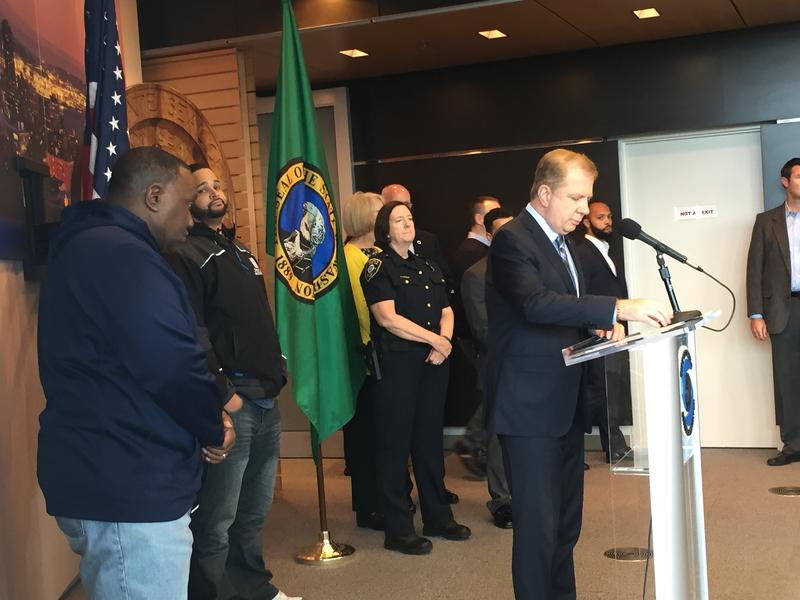 Mayor Ed Murray and Police Chief Kathleen O'Toole address the social consequences of systematic racism at a press conference.