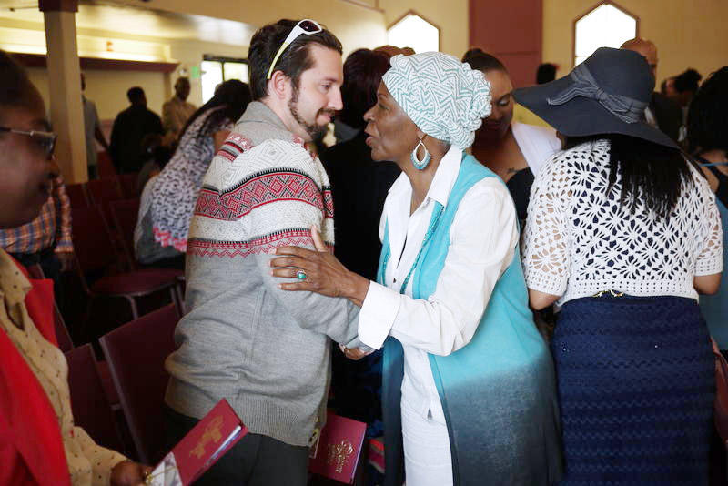 Mount Calvary member Vera Brooks greets a newcomer at Sunday service.