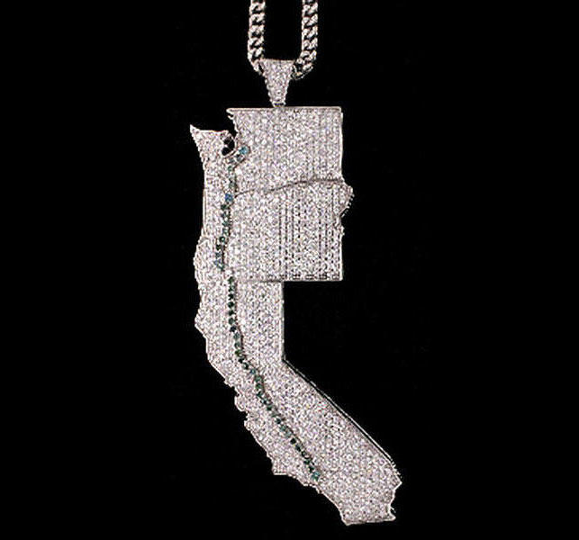 Jevon Lawson wore a diamond pendant with pale green gems mimicing the OxyContin trail from Los Angeles to Washington state.