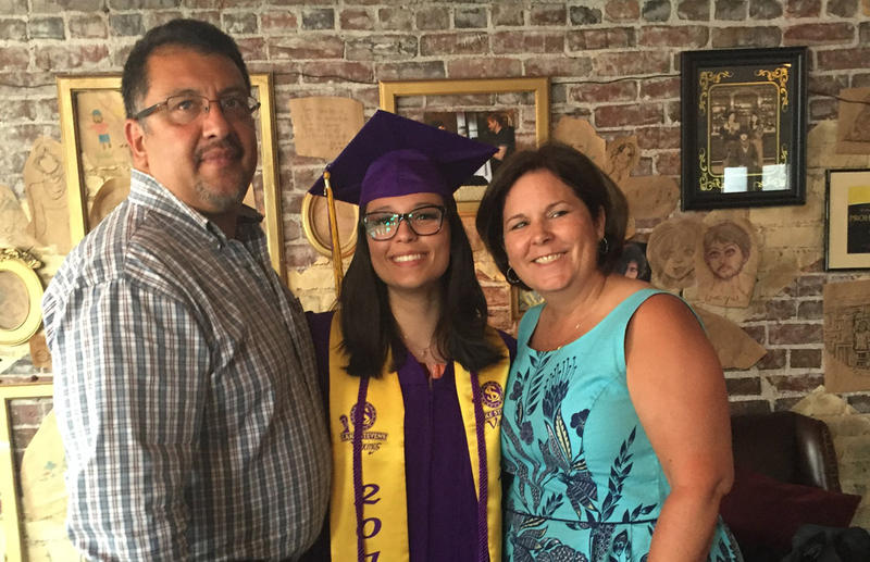 Noel Gasca poses for a graduation shot with her father, Rick Gasca, and mother, Kim Chapman.
