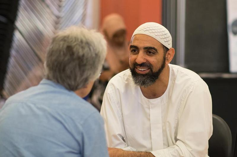 Mohamed Bakr talks with Glenda Johnson (left) at KUOW's Ask a Muslim event on July 24, 2016 at the New Holly Gathering Hall.