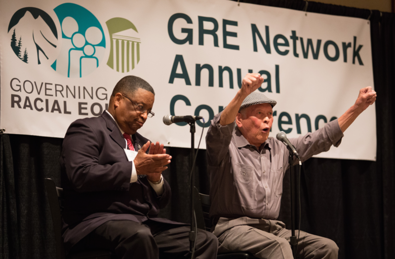 Bob Santos (right) and Larry Gossett at a 2015 racial equity conference. Both men were part of the so-called