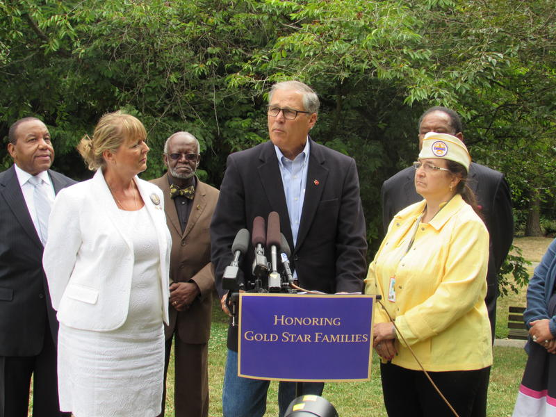 Governor Jay Inslee (center) with Gold Star mother Monica McNeal (left) and Gold Star wife Arlene Murray (right) at Seattle's Alvin Larkins Park.