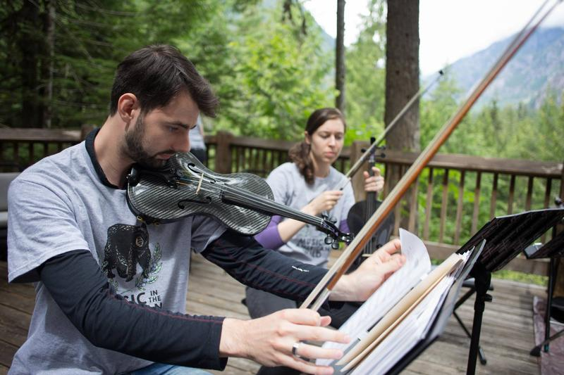 Jeremy Pots and Emily Sheil perform in the North Cascades National Park.