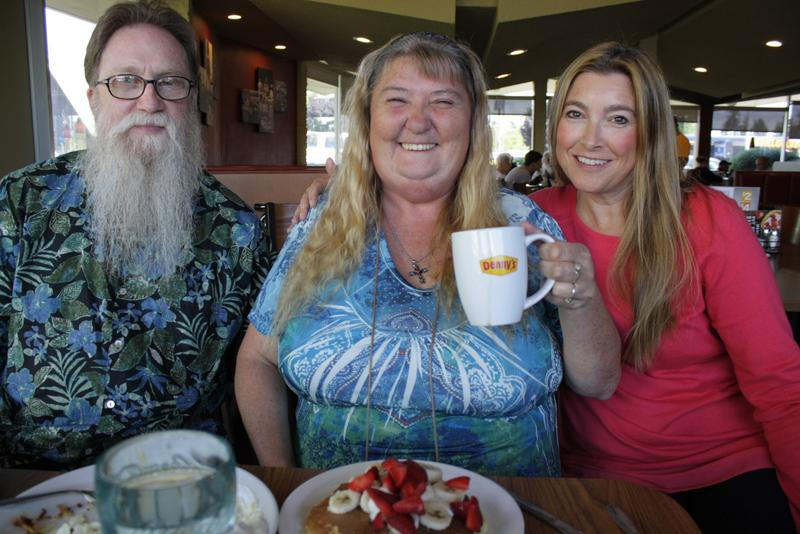 Sandra Anderson enjoys a celebratory meal at one of her favorite restaurants with Kevin Krause and Ravenna Candy from the nonprofit, Navos. Anderson is graduating from Navos' housing program – her apartment will be signed over to her name.