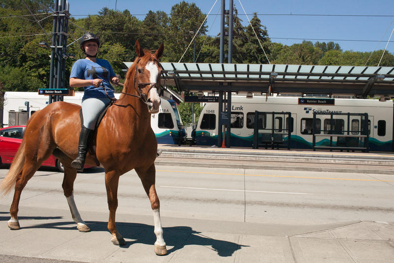 Annie DeFranco, friend of the Sferra family, on her horse Cody at Rainier Beach link light rail station.