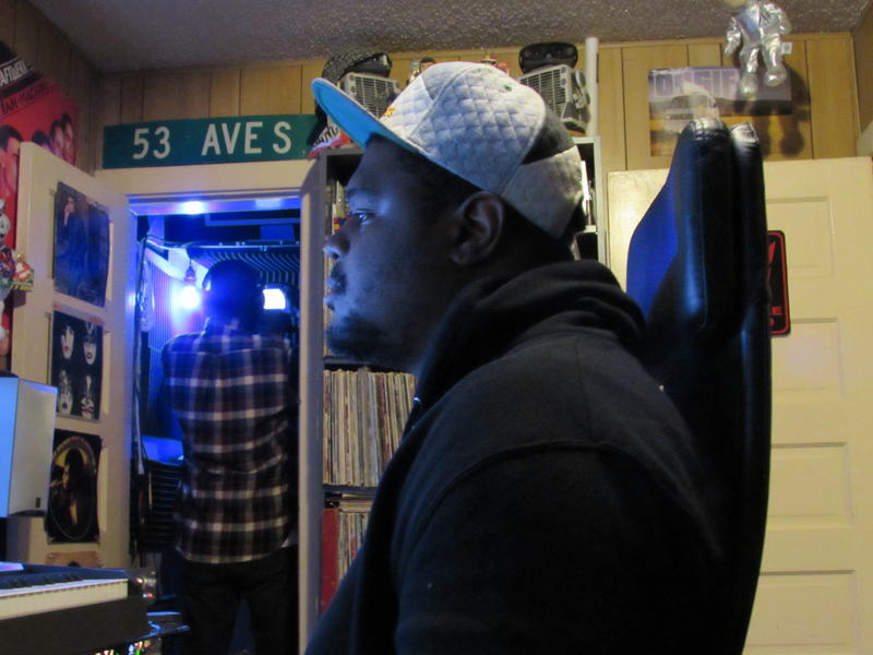 Music producer Jay Battle (aka Qreepz) at the control board, recording Yirim Seck's raps.
