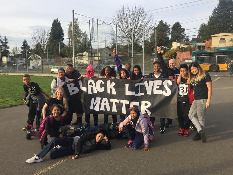 Students and teachers gathered around a Black Lives Matter banner before the school day began at White Center Heights Elementary.