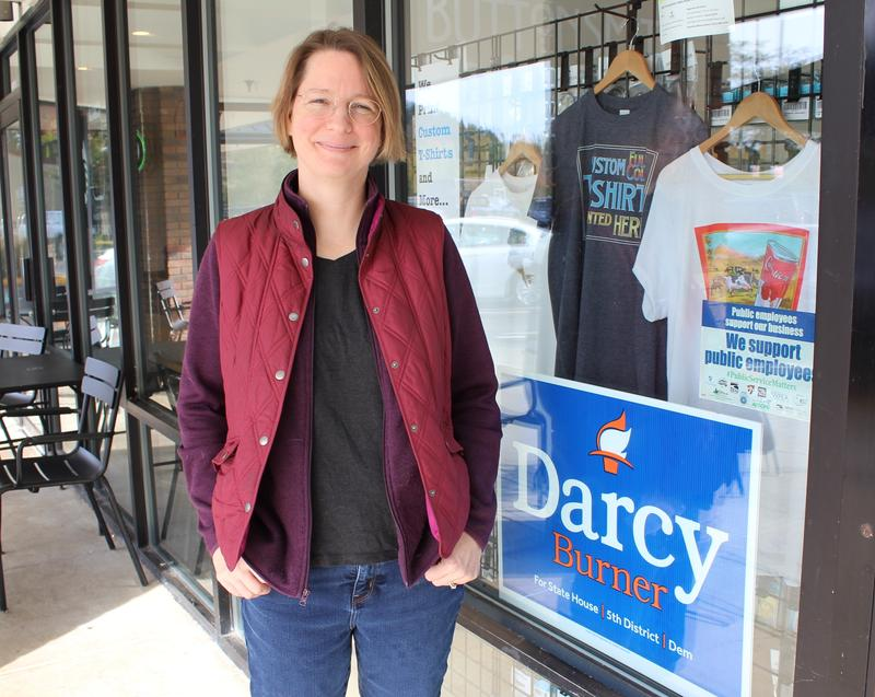 Democrat Darcy Burner, who is running for state representative in the 5th Legislative District, stands in front of her button-making shop in Carnation.