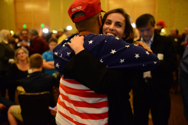 Friends hug at the Republican watch party on Tuesday night in Bellevue.